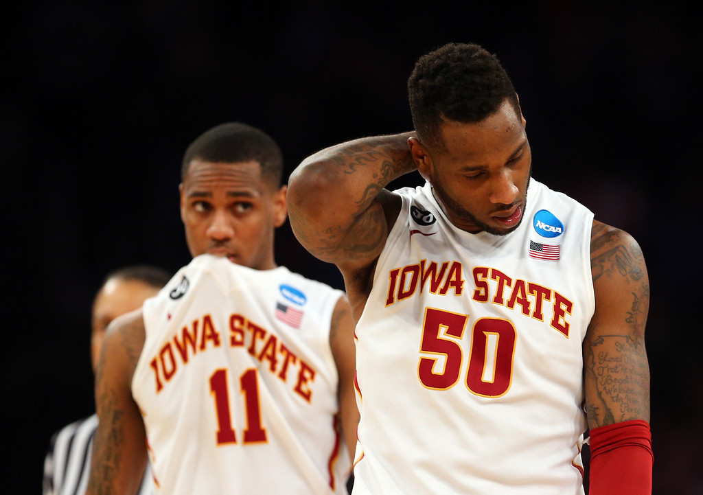 . DeAndre Kane #50 and Monte Morris #11 of the Iowa State Cyclones react late in the game against the Connecticut Huskies during the regional semifinal of the 2014 NCAA Men\'s Basketball Tournament at Madison Square Garden on March 28, 2014 in New York City.  (Photo by Elsa/Getty Images)