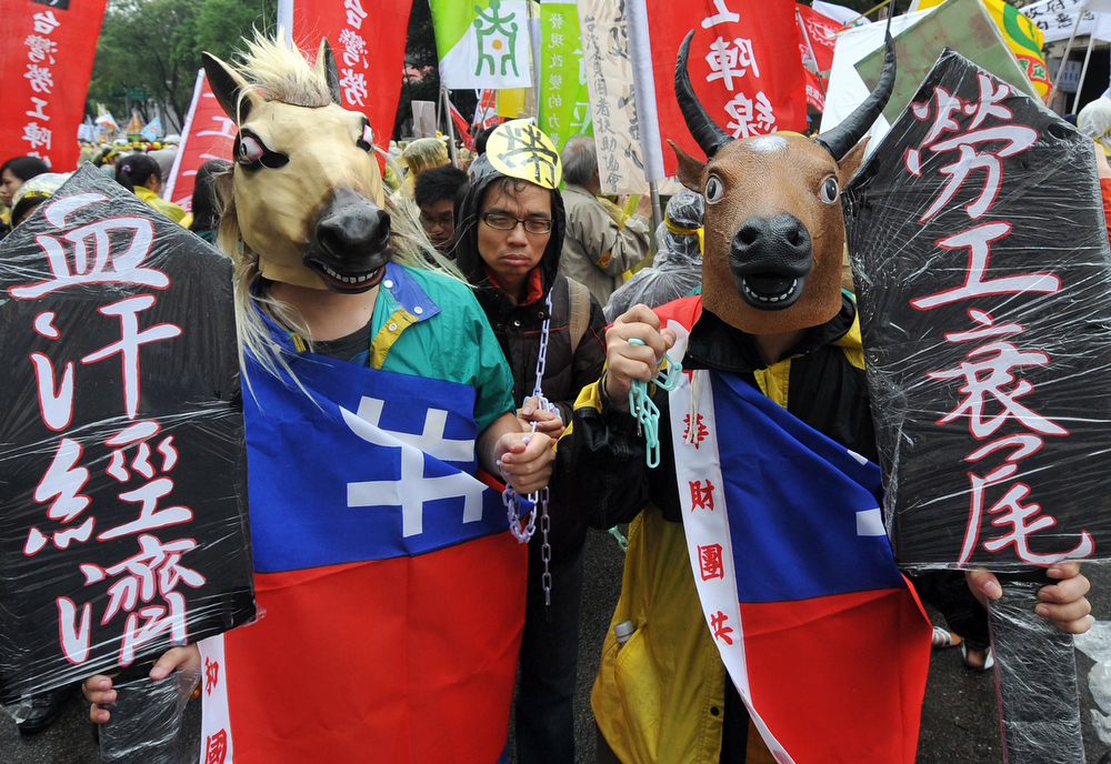 . Demonstrators attend a a May Day rally in Taipei on May 1, 2013. More than 10,000 people took to the streets in Taipei to protest the government\'s planned pension cuts, including raising labour insurance fees and lowering the payment scale.  Mandy Cheng/AFP/Getty Images