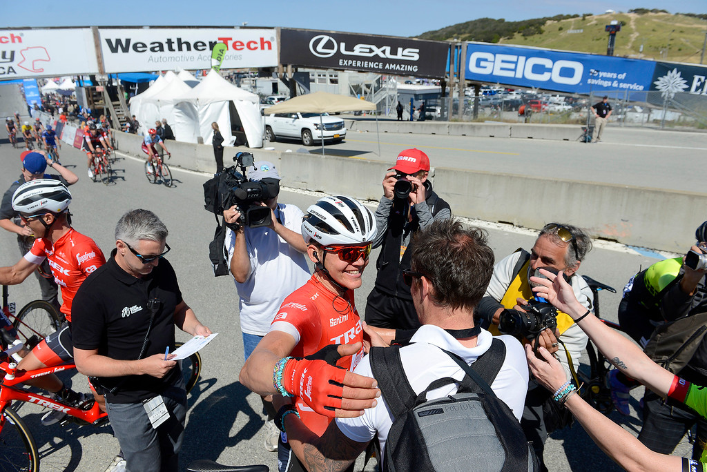 . Toms Skujins from Latvia is congratulated after winning the Stage 3 at Laguna Seca Raceway in Monterey on Tuesday, May 15, 2018 during the Amgen Tour of California.  (Vern Fisher - Monterey Herald)