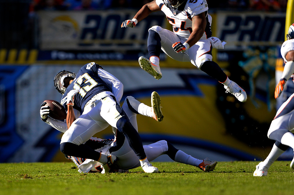 . SAN DIEGO, CA. December 14, -wide receiver Keenan Allen #13 of the San Diego Chargers is bent backward during a reception at Qualcomm Stadium December 14, 2014 San Diego, CA (Photo By Joe Amon/The Denver Post)