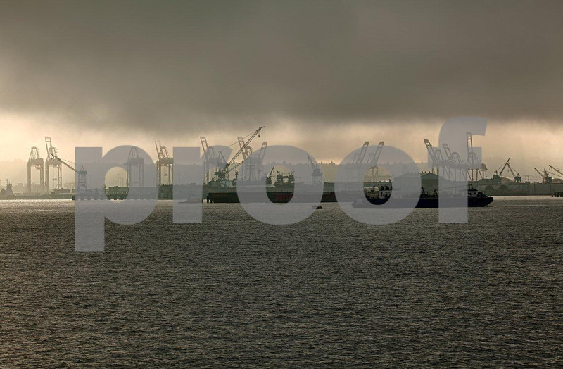 The Port of Seattle starts the day under a heavy layer of clouds on September 26, 2012 in Elliot Bay, Seattle, WA. 0545