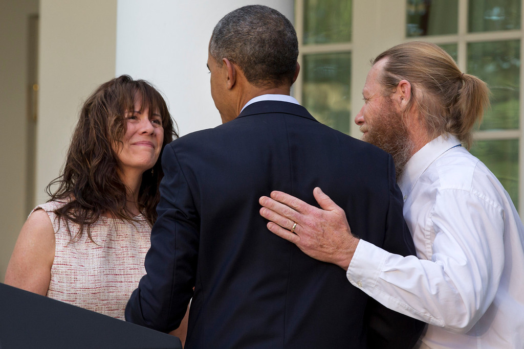 . Parents of U.S. Army Sgt. Bowe Bergdahl, Jani Bergdahl, left, and Bob Bergdahl, turn to President Barack Obama after he spoke in the Rose Garden of the White House in Washington, Saturday, May 31, 2014, after the announcement that Bowe Bergdahl has been released from captivity in Afghanistan. Bergdahl, 28, had been held prisoner by the Taliban since June 30, 2009. He was handed over to U.S. special forces by the Taliban in exchange for the release of five Afghan detainees held by the United States. (AP Photo/Jacquelyn Martin)