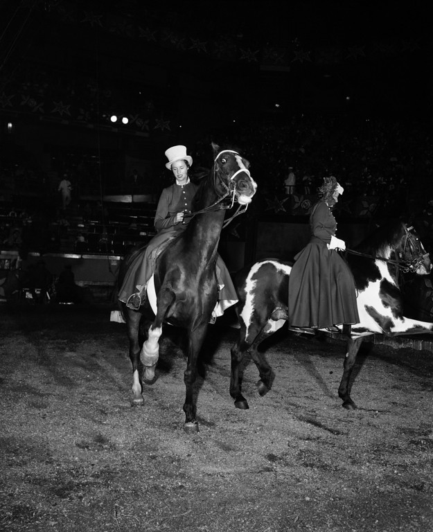 . When 17-year-old Ilonka Karoly steps into the circus ring, spectators wonder how one of her age and size can do all the things she does at one performance. Ilonka is a ballerina with the Ringling Bros. and Barnum and Bailey circus in New York, May 12, 1956. (AP Photo/Robert Kradin)