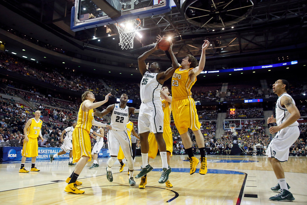 . Valparaiso guard Matt Kenney (23) defends against a shot by Michigan State forward Derrick Nix (25) in the first half of a second-round game of the NCAA college basketball tournament Thursday, March 21, 2013, in Auburn Hills, Mich. (AP Photo/Duane Burleson)