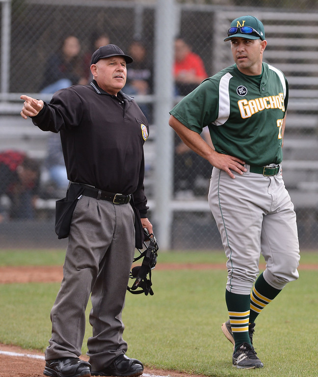 . 0507_SPT_TDB-L-NARB-BANN--20130506-- Photo: Robert Casillas / LANG     Bannning defeated visiting Narbonne 8-2 to clinch share of Marine League baseball title. Narbonne coach Bill Dillon has a different view of call.