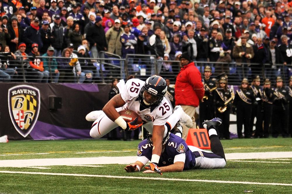 . Denver Broncos cornerback Chris Harris #25 beats  Baltimore Ravens quarterback Joe Flacco #5 to the endzone for a touchdown in the first half against the Baltimore Ravens at the M&T Bank Stadium, in Baltimore , MD Sunday December 16, 2012.      Joe Amon, The Denver Post