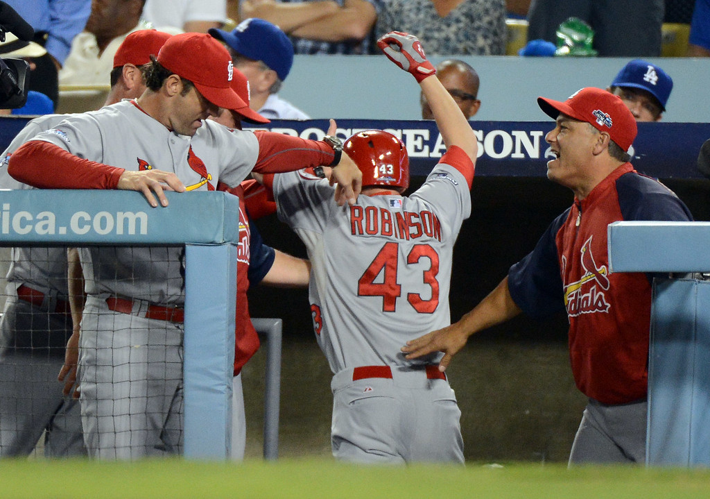 . The Cardinals\' Shane Robinson enters the dugout after hitting a home run in the 7th against the Dodgers during game 4 of the NLCS at Dodger Stadium Tuesday, October 15, 2013. (Photo by David Crane/Los Angeles Daily News)