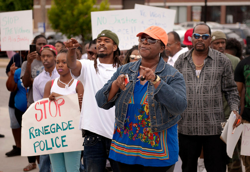 . Protestors confront police during an impromptu rally, Sunday, Aug. 10, 2014 to protest the shooting of Michael Brown, 18, by police in Ferguson, Mo. on Saturday. Brown died following a confrontation with police, according to St. Louis County Police Chief Jon Belmar, who spoke at a news conference Sunday. The protesters rallied in front of the police and fire departments in Ferguson following Belmar\'s news conference. (AP Photo/Sid Hastings)