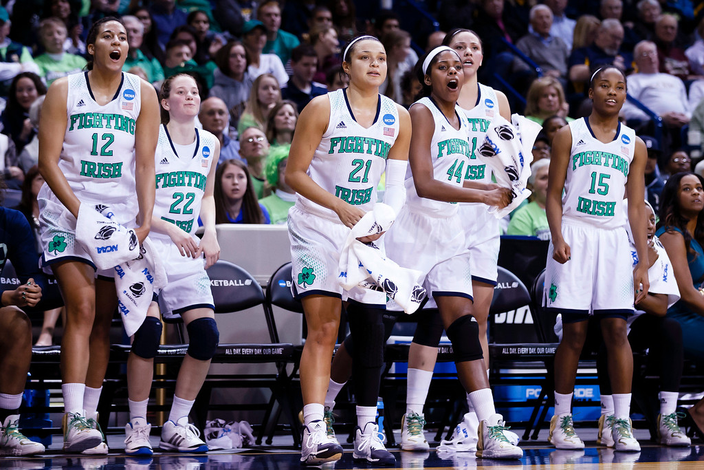. From left, Notre Dame forward Taya Reimer, guard Madison Cable, guard Kayla McBride, forward Ariel Braker, Natalie Achonwa and guard Lindsay Allen celebrate a basket against Arizona State during the second half in a second-round game in the NCAA women\'s college basketball tournament in Toledo, Ohio, Monday, March 24, 2014. (AP Photo/Rick Osentoski)