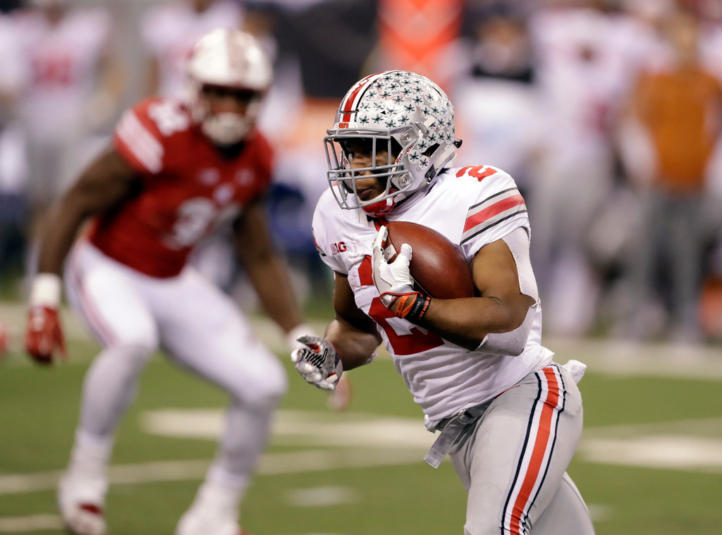 . Ohio State running back J.K. Dobbins runs with the ball during the second half of the Big Ten championship NCAA college football game against Wisconsin, Saturday, Dec. 2, 2017, in Indianapolis. (AP Photo/Darron Cummings)