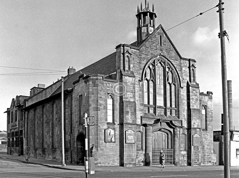 Dalmarnock Rd.  Bridgeton Congregational Church, one of the very few old buildings left now in Dalmarnock Rd. The Zion Hall Pentecostal Church relocated here from Green St in the Calton.    January 1976