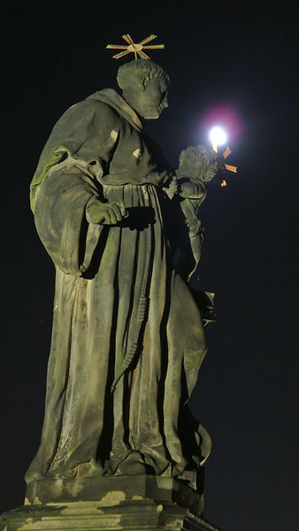 Charles Bridge statue with moon