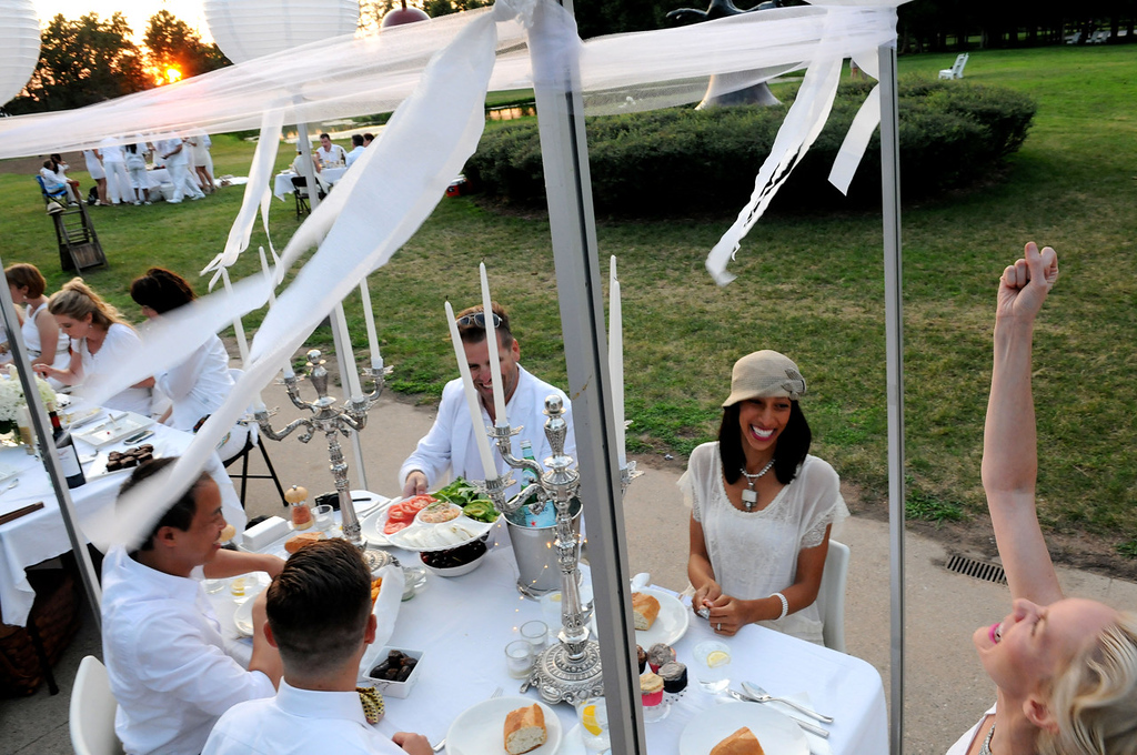 . Friends, clockwise from foreground, Tony Vu, Michael Weinbeck, Tim Trudeau, Fatima Trudeau and Hollie Mae Schultz enjoy their first Dinner in White. (Pioneer Press: Sherri LaRose-Chiglo)