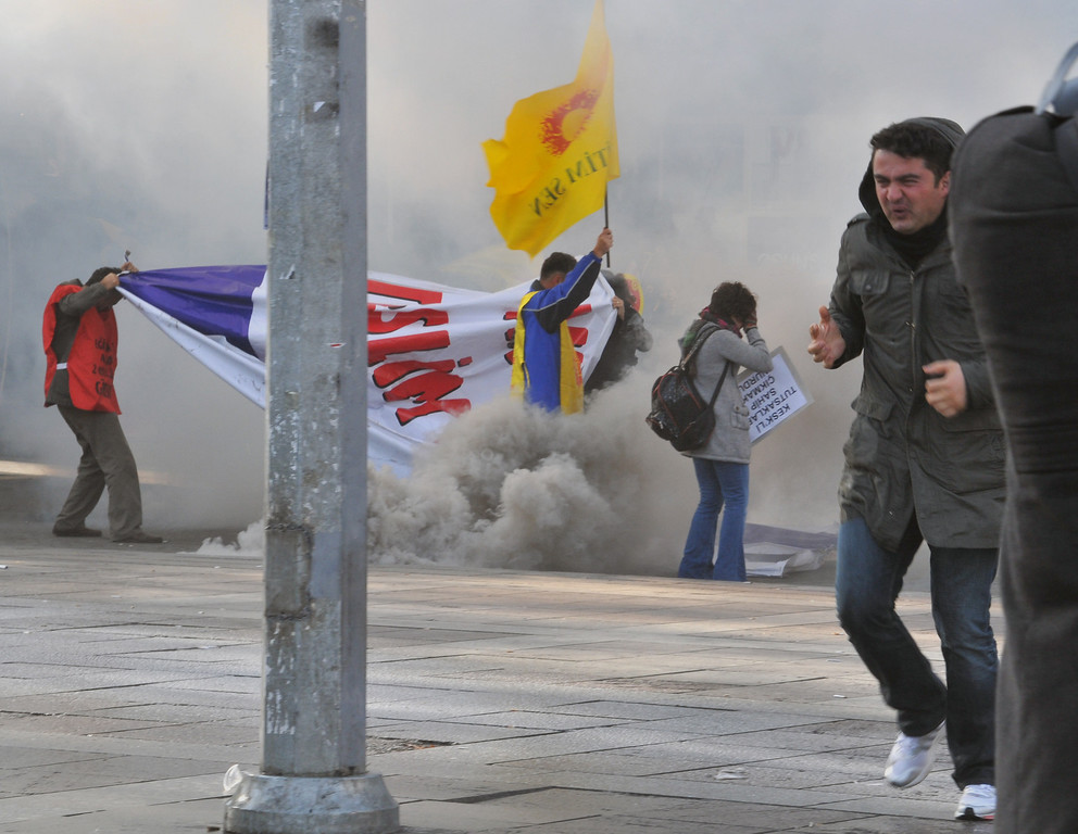 . People run as riot police use water cannons and pepper gas to disperse thousands of Turkish teachers who were gathered to protest against the government\'s education and economic policies in Ankara, Turkey, Saturday, Nov. 23, 2013.(AP Photo)