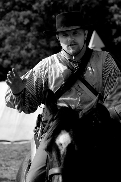 A Confederate cavalry reenactor explains how the cavalry worked during the time period at Patriots Point in Mt. Pleasant, South Carolina on Sunday, April 10, 2011. ..The 150th Anniversary of the Firing on Ft. Sumter was commemorated with lectures, performances, demonstrations, and a living history throughout the area on James Island, Charleston, Mt. Pleasant, and Sullivan's Island during the week from April 8-14, 2011. Photo Copyright 2011 Jason Barnette