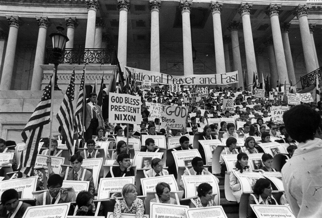. 29th July 1974:  A prayer vigil in support of Republican President Richard Nixon during the Watergate crisis.  (Photo by Keystone/Getty Images)