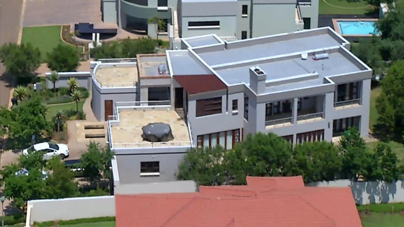 . This aerial image taken from video provided by VNS24/7 on Thursday Feb. 14, 2013, shows the home of Olympic athlete Oscar Pistorius in a gated housing complex in Pretoria, South Africa. Olympic athlete Oscar Pistorius has been arrested in the shooting death of his girlfriend, police and the woman\'s talent agent said Thursday. (AP Photo/VNS24/7)