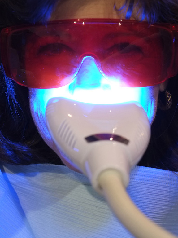 . A visitor gets her teeth whitened at the Teeth Bright booth during the 2014 International CES at the Las Vegas Convention Center on January 8, 2014 in Las Vegas, Nevada. CES, the world\'s largest annual consumer technology trade show, runs through January 10 and is expected to feature 3,200 exhibitors showing off their latest products and services to about 150,000 attendees. AFP PHOTO/JOE KLAMAR/AFP/Getty Images