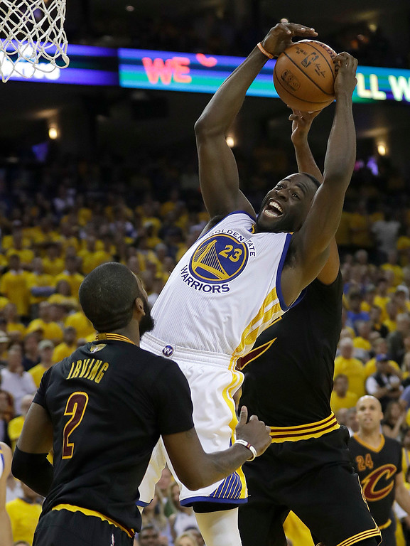 . Golden State Warriors forward Draymond Green (23) grabs a rebound against the Cleveland Cavaliers during the second half of Game 2 of basketball\'s NBA Finals in Oakland, Calif., Sunday, June 4, 2017. (AP Photo/Marcio Jose Sanchez)