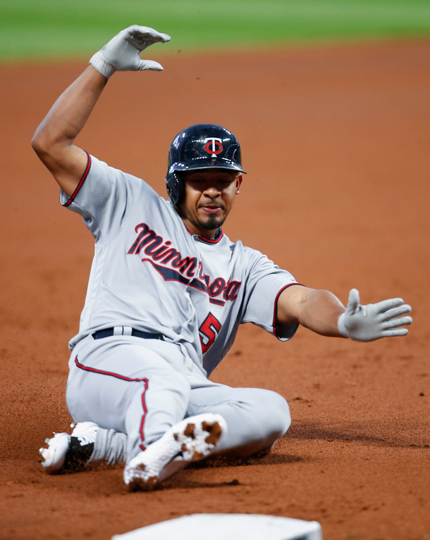 . Minnesota Twins\' Eduardo Escobar slides safely into third base with a triple off Cleveland Indians starting pitcher Josh Tomlin during the first inning in a baseball game, Tuesday, Sept. 26, 2017, in Cleveland. (AP Photo/Ron Schwane)