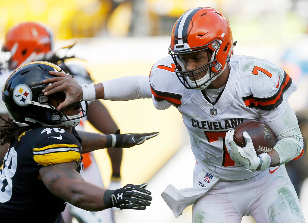 . Cleveland Browns quarterback DeShone Kizer (7) stiff arms Pittsburgh Steelers outside linebacker Bud Dupree (48) during the second half of an NFL football game in Pittsburgh, Sunday, Dec. 31, 2017. (AP Photo/Keith Srakocic)