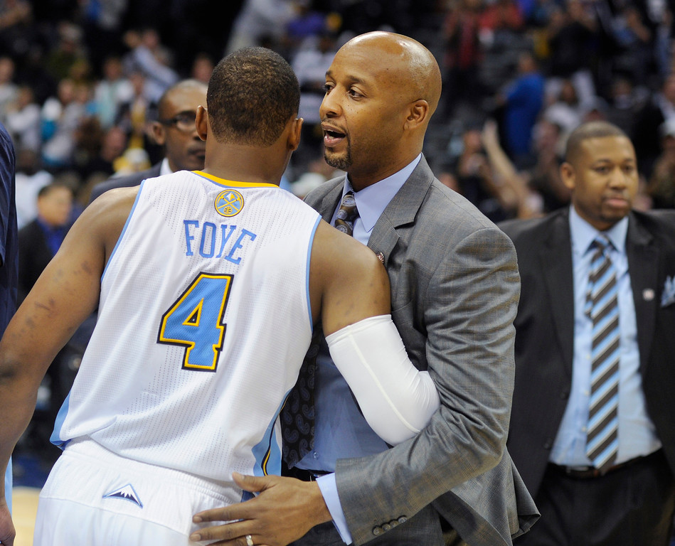 . Denver coach Brian Shaw congratulated Randy Foye after the win. The Denver Nuggets defeated the Atlanta Hawks 109-107 at the Pepsi Center Thursday night, November 7, 2013 for the first win of the season. Photo By Karl Gehring/The Denver Post