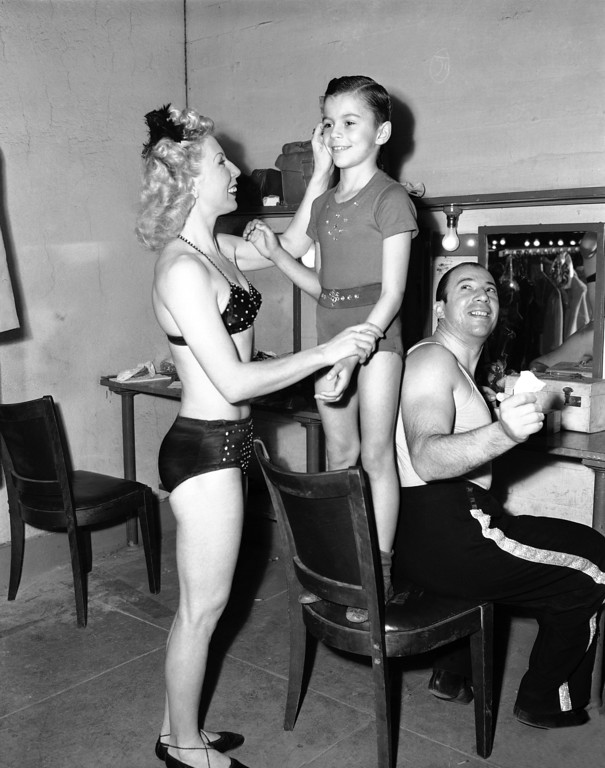 . Three of the �Four Sandys� backstage at the circus in White Plains, New York on Feb. 25, 1952. Sandy Dobritch, seven-year-old aerial acrobat, and his parents, Pia and Alexander Dobritch. The act is named for the youngster. (AP Photo/Bob Wands)
