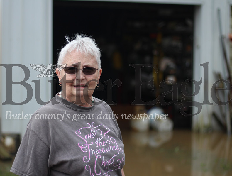 Marilyn Nicklas, of Evans City is pictured here in front of her flooded property on North Washington Street. She said its the worst flooding she has seen in 14 years.