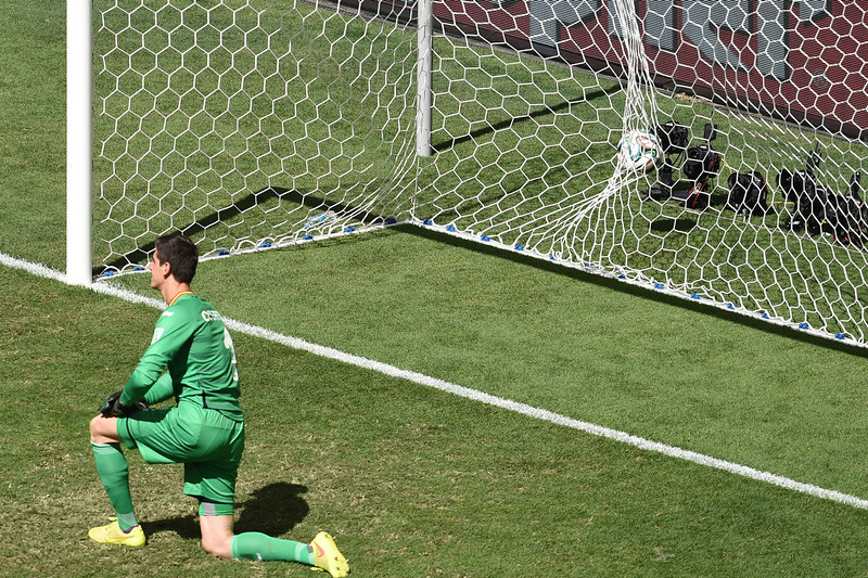 . Belgium\'s goalkeeper Thibaut Courtois fails to stop a ball kicked by Argentina\'s forward Gonzalo Higuain during a quarter-final football match between Argentina and Belgium at the Mane Garrincha National Stadium in Brasilia during the 2014 FIFA World Cup on July 5, 2014.   (EVARISTO SA/AFP/Getty Images)