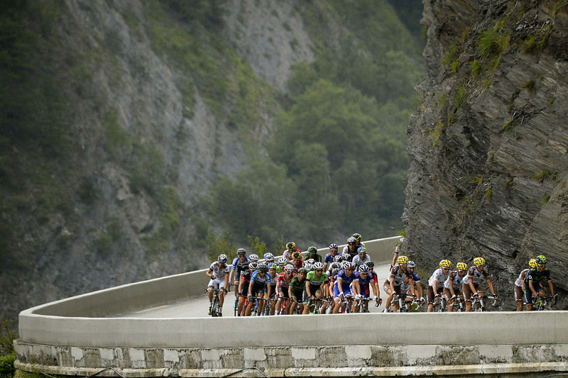 . The pack rides during the 177 km fourteenth stage of the 101st edition of the Tour de France cycling race on July 19, 2014 between Grenoble and Risoul, central eastern France. (LIONEL BONAVENTURE/AFP/Getty Images)