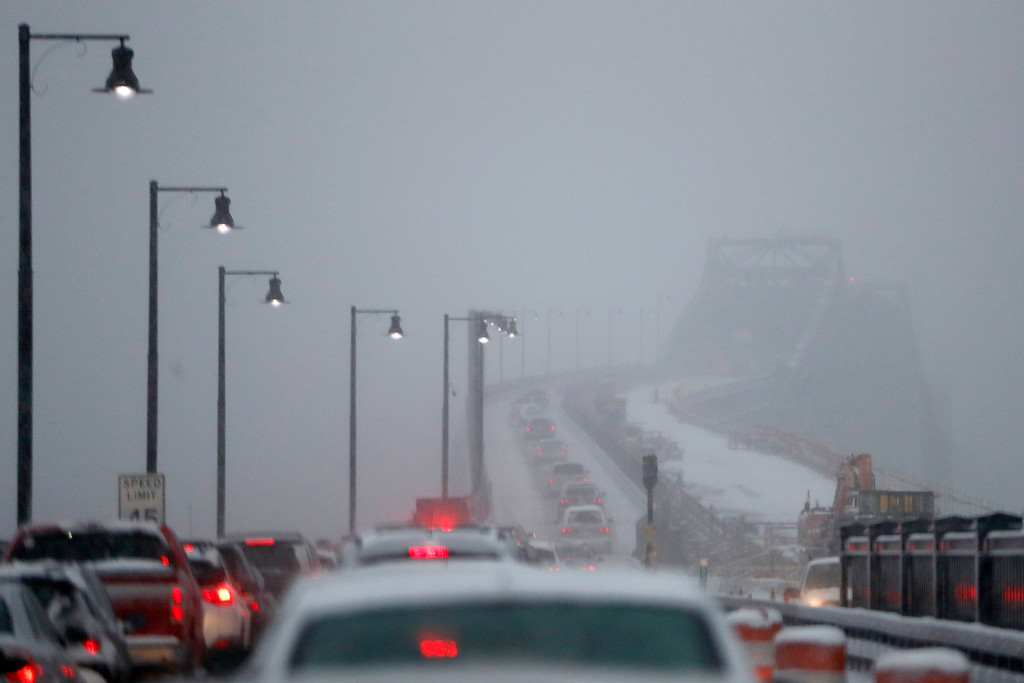 . Traffic moves westbound on the Pulaski Skyway under a snowstorm, Saturday, Jan. 7, 2017, in Jersey City, N.J. (AP Photo/Julio Cortez)