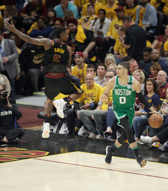 . Cleveland Cavaliers\' JR Smith (5) leaps as he defends against Boston Celtics\' Jayson Tatum (0) in the second half of Game 3 of the NBA basketball Eastern Conference finals, Saturday, May 19, 2018, in Cleveland. (AP Photo/Tony Dejak)