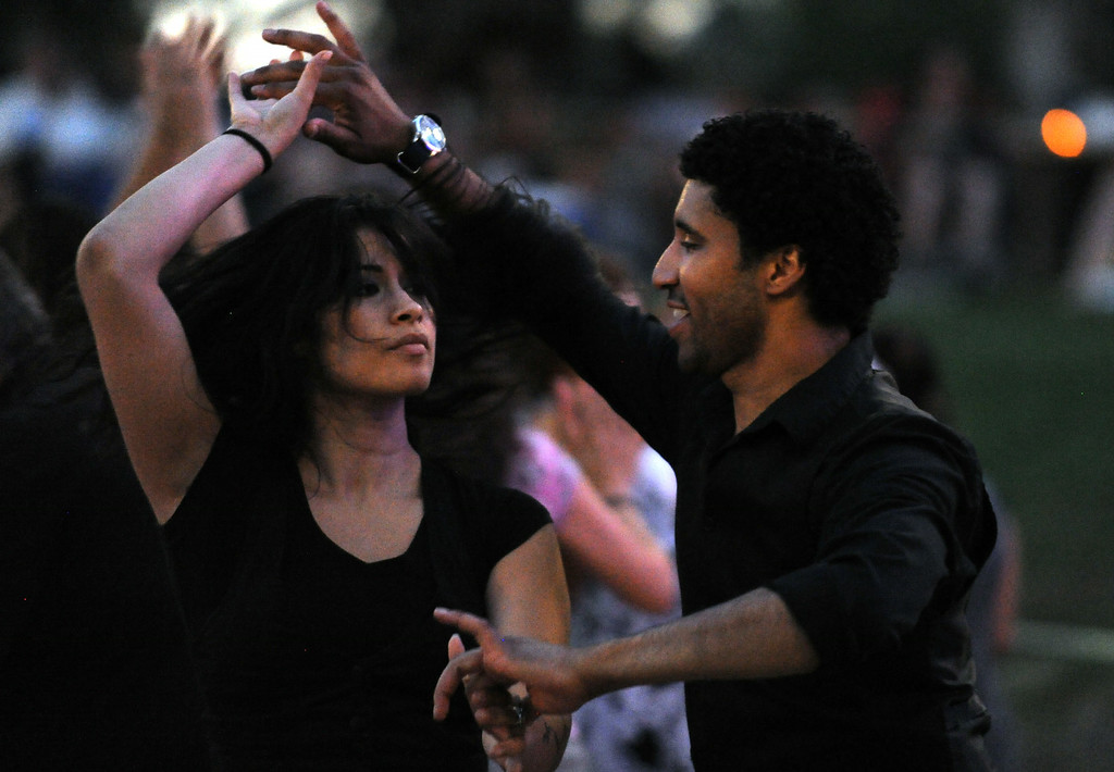 . A couple dances as Adonis Puentes and the Voice of Cuba orchestra perform at the Redlands Bowl on Friday, July 11, 2014 in Redlands, Ca. (Micah Escamilla/Redlands Daily Facts)
