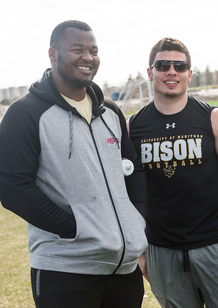 DAVID LIPNOWSKI / WINNIPEG FREE PRESS  Former University of Manitoba Bisons' David Onyemata( left) and  DJ Lalama at the University of Manitoba Bisons 2016 spring camp Sunday May 1, 2016 at the University of Manitoba Turf Fields. David Onyemata is the first Bison to be drafted into the NFL and DJ Lalama just signed on to go to New York Giants mini-camp.