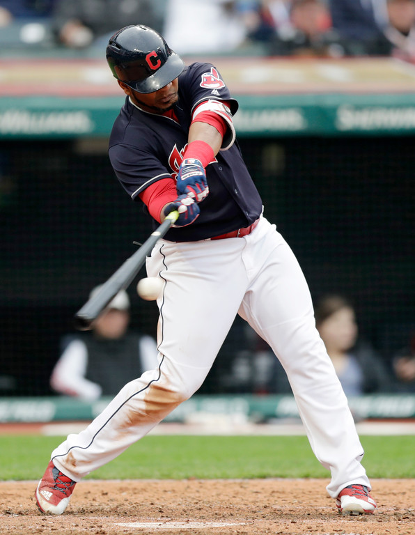 . Cleveland Indians\' Edwin Encarnacion hits an RBI-single off Kansas City Royals Kevin McCarthy in the seventh inning of a baseball game, Saturday, May 12, 2018, in Cleveland. (AP Photo/Tony Dejak)