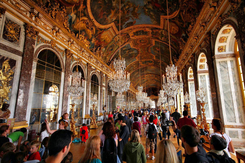 Hall of Mirrors. I had wanted a photo of this room without a lot of people in it.. Yeah, right. INTERESTING FACT: The King ordered that all items in the Palace must be made in France, but Venice had a tight monopoly on mirror secrets. The French secretly solicited Venetian mirror artists to come here and make the mirrors for this room. When Venice found out, an order was issued for the assassination of the artists who did it. Patent disputes are obviously not a new phenomenon.