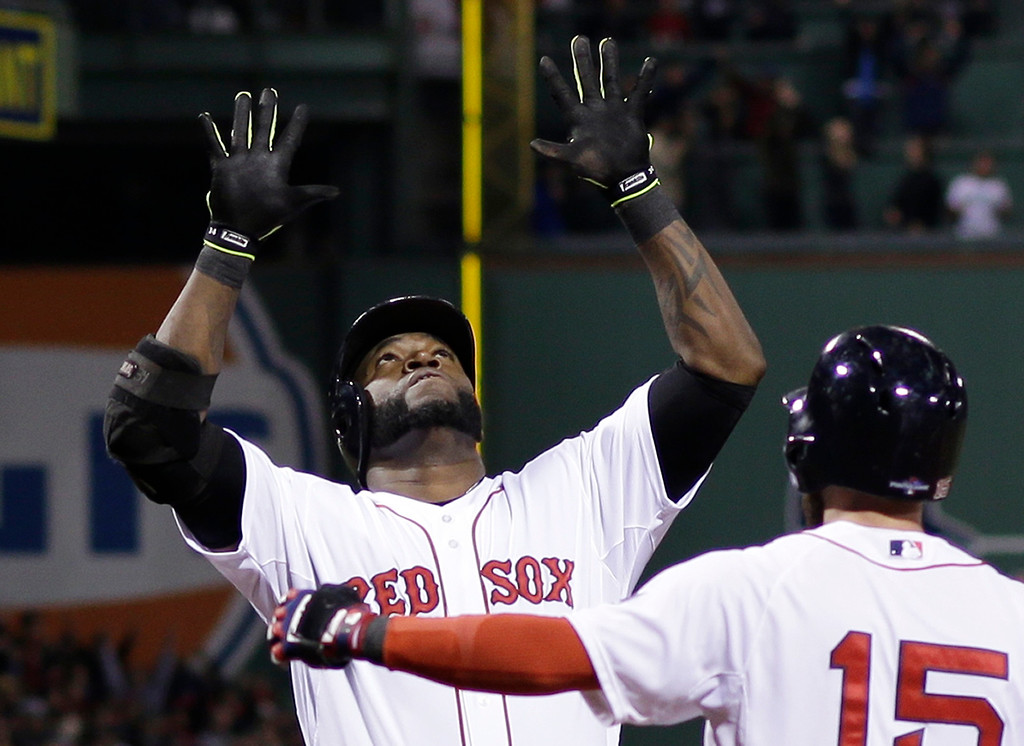 . Boston Red Sox\'s David Ortiz celebrates with Dustin Pedroia after hitting a grand slam home run in the eighth inning during Game 2 of the American League baseball championship series against the Detroit Tigers Sunday, Oct. 13, 2013, in Boston. (AP Photo/Matt Slocum)