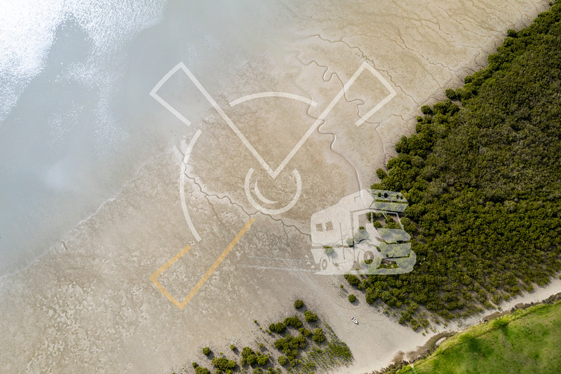 Top view of a boat laying on the shore in Matakohe area, New Zealand.
