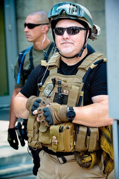 A right wing member decked out in his gear gives me a slight smile.