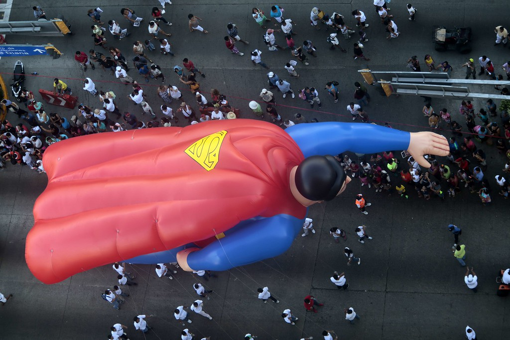 . A giant balloon with the shape of Superman participates in the Christmas parade in Acapulco, Guerrero state , Mexico, on December 25, 2013. Pedro PARDO/AFP/Getty Images