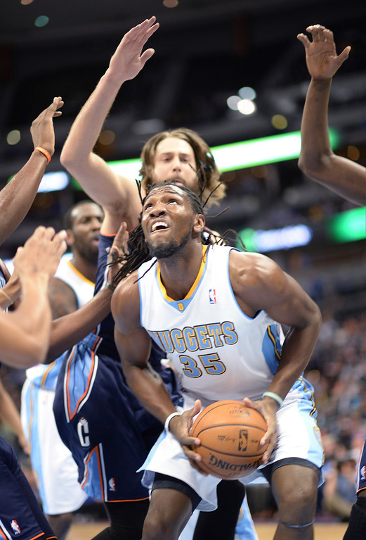 . Kenneth Faried of Denver Nuggets (35) controls the offensive rebound in the first half of the game. (Photo by Hyoung Chang/The Denver Post)