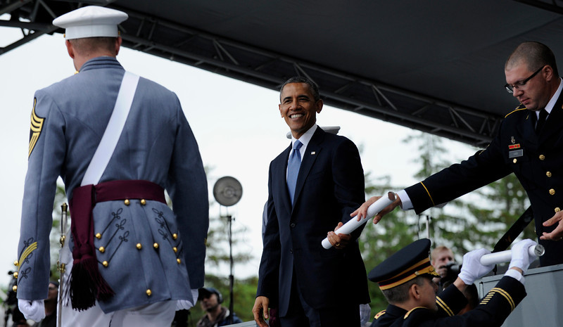 . President Barack Obama hands out diplomas to the graduating class of the U.S. Military Academy at West Point in West Point, N.Y., Wednesday, May 28, 2014. Obama delivered the commencement address and talked about his Afghanistan plan and answered critics who say he has surrendered America\'s global leadership. (AP Photo/Susan Walsh)