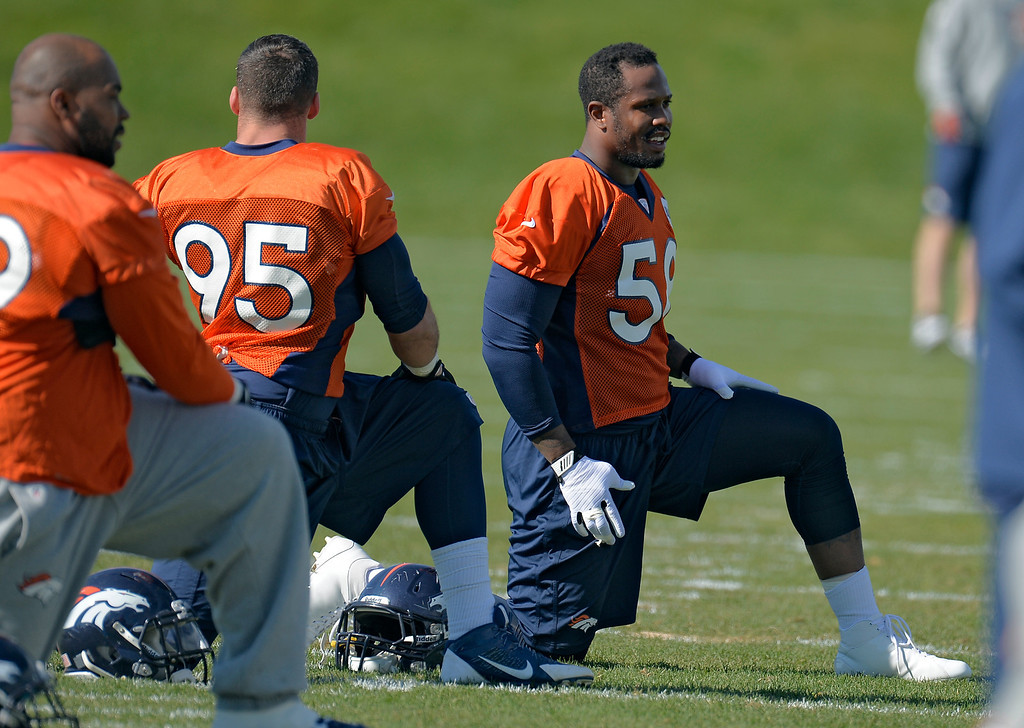 . Denver Broncos outside linebacker Von Miller (58) smiles on his first day back to practice at with the team October 16, 2013 at Dove Valley after serving a six game suspension. (Photo by John Leyba/The Denver Post)