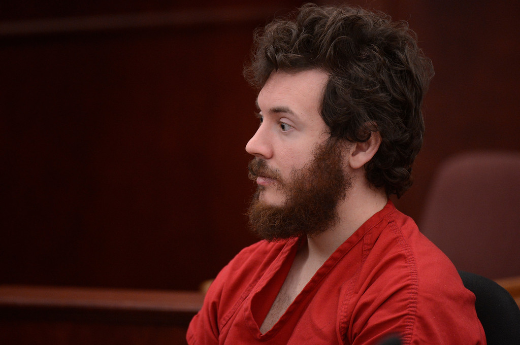 . Aurora theater shooting suspect James Holmes in the courtroom during his arraignment Tuesday March 12, 2013. District Court Judge William Sylvester entered a Not Guilty plea on behalf of Holmes. The trial begins August 5, 2013.(Photo By RJ Sangosti/The Denver Post)