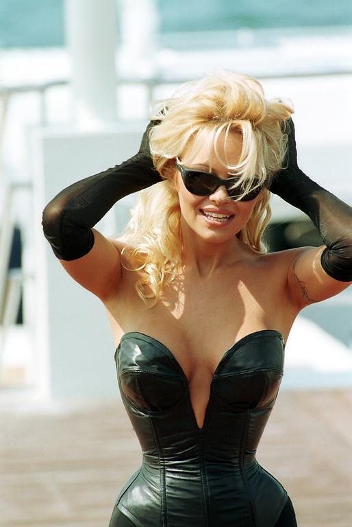 . American television star Pamela Anderson poses on the French Riviera beach during the 48th Cannes International Film Festival in Cannes, France, Saturday, May 20, 1995.  (AP Photo/Remy de la Mauviniere)