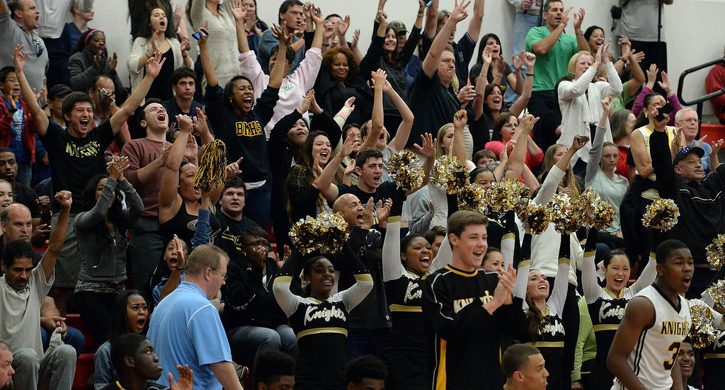 . Bishop Montgomery fans celebrate as they defeated Cantwell 66-56 during a CIF Southern California Regional Division IV basketball game at Colony High School in Ontario, Calif., on Saturday, March 22, 2014.  (Keith Birmingham Pasadena Star-News)