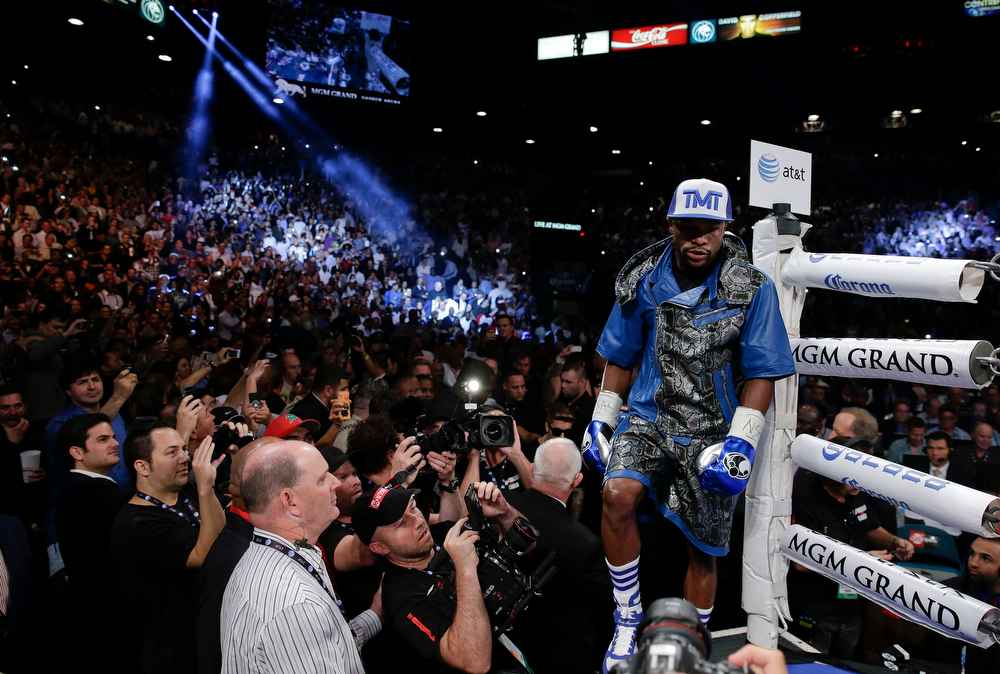 . Floyd Mayweather Jr. steps into the ring for a 152-pound title fight against Canelo Alvarez, Saturday, Sept. 14, 2013, in Las Vegas. (AP Photo/Eric Jamison)