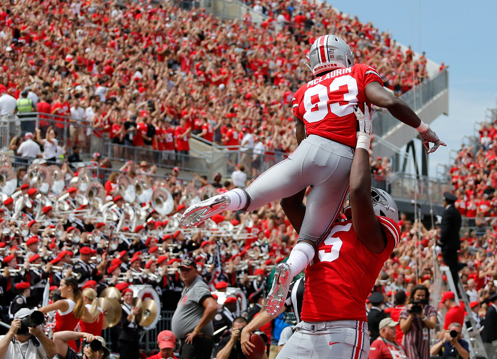 . Ohio State receiver Terry McLaurin is lifted in celebration by teammate Jaylen Harris after scoring a touchdown against Oregon State during the first half of an NCAA college football game Saturday, Sept. 1, 2018, in Columbus, Ohio. (AP Photo/Jay LaPrete)