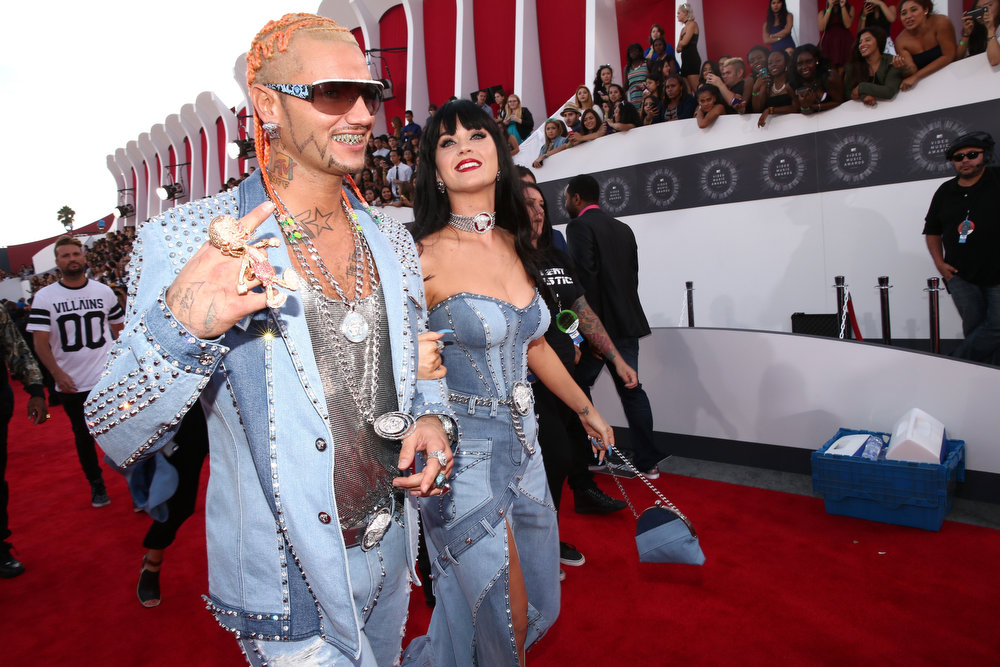 . Rapper Riff Raff (L) and recording artist Katy Perry attend the 2014 MTV Video Music Awards at The Forum on August 24, 2014 in Inglewood, California.  (Photo by Christopher Polk/Getty Images for MTV)