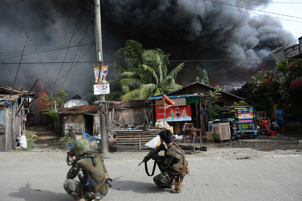 . Philippine soldiers aim their rifles at enemy positions during a fire fight with Muslim rebels in Zamboanga City in southern island of Mindanao on September 12, 2013.    AFP PHOTO/TED ALJIBE/AFP/Getty Images